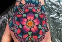 Tattoos and piercings / Just color scheme, and ideas to help me put together my half sleeve!  / by Brittany Lewis