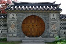 Moon Gate / The moon gate is an ancient Chinese landscape element that acts as a portal between gardens as well as between inside and outside.   One interpretation of the moon gate is that it is complete, representing and celebrating the cohesiveness of the family.   Another interpretation is that the moon gate, as it lifts itself out of the landscape, is symbolic of birth and renewal.  Yet another interpretation is that the moon gate is, like the moon, a connection to other planets and other worlds.    / by Gail Silveira