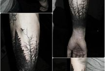 Black work arm tattoos forest