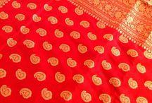 Stuti sarees / A crimson red kadhua saree. Traditional paisley motifs.