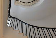 Elliptical Staircase / This spectacular Cantilevered Helical Staircase over 5 floors was commissioned by developers for an elegant period house that was totally re-constructed in the heart of St John's Wood and will be one of the most outstanding properties to come on the market this year. The steel carriage was clad in fine white satin marble with a plastered soffit.
