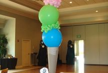 Balloon Centerpieces / Balloon centerpieces, also called balloon bouquets, play a central role in decorating your venue with balloons. You can make them with or without helium. Our collection here is just a small sample of the variety of colors, sizes, and designs you can create.