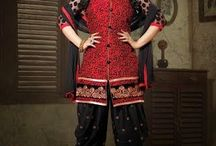 BabyDoll3 / Superbly designed patiyala style salwar suit with heavy thread work done. Along with Contrast Bottom with Embroidered Buttas and Duppatta.