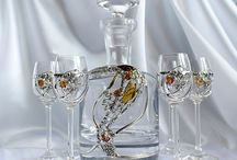 Carafes and glasses decorated with Baltic amber. / Art glass decorated with natural Baltic amber.