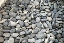 Rock on! / There are many different options of rock to choose from for your Water Feature. Glass, stone, boulders, pebbles, etc. Check all the different kinds available to make the best choice for what style goes with your outdoor space.