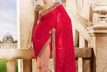 Womaniya 2 / Beautifully designed Georgette saree with heavy embroidery work en-crafted all over. Comes along with Contrast matching Blouse.
