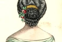 Ladies' Hair - Later Victorian/Civil War Era / Late 1850s and 1860s. Characterized by center parts, soft puffs of hair around the face and ears, wider overall silhouette, curls and braids on the back of the head, hairnets or snoods in wide use