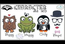 Character Die Sets by Karen Burniston / Projects using Karen Burniston Character die sets for Elizabeth Craft Designs - #908 Chilly the Penguin, #909 Hoppy the Frog, #910 Poppy the Owl, #911 Props 1, #946 Dutch the Fox, #948 Honey the Bear, #949 Props 2, #982 Props 4 (pets), #983 Whiskers the Cat, #984 Buster the Dog, #985 Rocky the Crab, #986 Props 3 (snorkel), #1023 Cheepers the Chicken, #1024 Virgil the Pig, #1023 Brownie the Cow