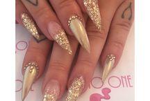 stiletto gold nails