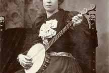 Women playing banjos