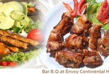 Bar BQ at Envoy Continental Hotel / Well designed Bar. B.Q on roof top. We provide highest quality of food, services, comfort and atmosphere. We manage moderate temperature and live music, light-appetite selections and open air relaxing environment. Giant screen T.V and night view of Islamabad. We are popular for providing an excellent dining experience with superior service which establishes reputation. We arrange fresh food for live Bar. B. Q, because we are well aware the freshness of the product is biggest key to success.