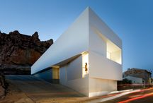 House on the Castle Mountainside.  Architecture by Fran Silvestre Arquitectos. / House on Montaiside Overlooked by Castle. Ayora, Valencia. (Spain).     The building is located in a landscape of unique beauty, the result of a natural and evident growth. The mountain, topped by a castle, is covered by a blanket housing through a system of aggregation by simple juxtaposition of pieces generated fragmented target tissue that adapts to the topography.