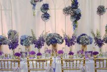 Amethyst + Gold Wedding / Styled with delicate and beautiful Amethyst hues and gold, the perfect wedding theme to show our teams styling prowess at a recent local Brisbane Wedding Expo. With a soft lilac satin base, this tablescape was adorned with glass gold rim charger plates, gold cutlery with soft gold Tiffany Chairs to carry this elegant theme throughout the space. Wedding Reception Styling Ideas. See the full film on our YouTube channel: youtu.be/rAbfWIOfl_4