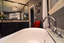 elegant master bathroom remodel / This elegant master bathroom remodel by Mountainwood Homes is the perfect balance of contrasts. The dark stained cabinetry against the pale Carrara marble counter tops play opposite the contemporary soaking tub, accented by the delicate glass chandelier. The custom tile shower is a magnificent backdrop for this peaceful oasis.