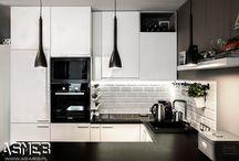 Kuchnia z Tarchomina, Warszawa / Biała kuchnia z frontami lakierowanymi w wysokim połysku. Kuchnia w salonie, nie dominuje, tylko dyskretnie wkomponowuje się w jego część, dzięki dodatkom i oświetleniu stanowi ozdobę wnętrza i przyjemny klimat.