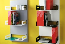EASY.STORAGE / It's a modular bookcase or filling system composed of a painted steel back panel which fits against a wall and three removable frosted PLEXIGLAS® trays.