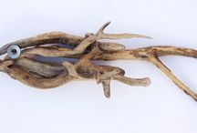 Drift wood sculptures and sea glass objects / art and craft from the sea from wood and glass