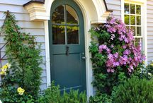 Welcome Home / ideas and inspiration for sidewalk, porch and door decor, front door paint color, front landscaping, container plants, urns, statuary