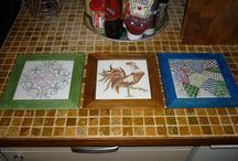 Hand Drawn Ceramic Tiles / Ceramic tiles, some kiln fired and others using oven baked semi permanent paints.