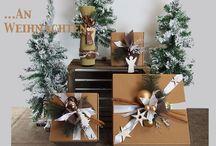 Schöner Schenken ... an Weihnachten. / Schöner Schenken mit fertig weihnachtlich dekorierten Geschenkekartons und Getränkehülsen gehalten. Mit farblich abgestimmten Akzente. Geliefert wie abgebildet.