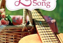 Like a Love Song / Coming April 2015: Susan Quinn, ex-social worker turned surrogate mom to foster teens, fights to save the home she's worked hard to build.   But she faces dwindling staff, foreclosure, & old heartaches that won't stay buried. Her only hope lies with the last person she'd ever turn to:  a brawny handyman with a guitar, a questionable past, and a God he keeps calling Father.  It's a romantic drama about a fiercely loyal woman & some castaway kids who need to believe in a love that never fails.