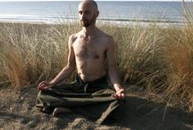 Yoga and meditation practice wearing kilts and hakamas / a meditative mediterranean mood : a Buddhism disciple practising the yoga with a menskirt in south of France. Postures of yoga on the beach, Buddha postures in male-skirt sitting on the dunes