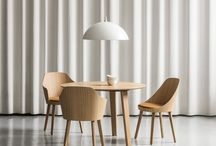 """Kaiak / Kaiak is a classic seat with a new fresh and contemporary design developed by Estudi Manel Molina.  It is characterized by the curved shape of the backrest that emphasizes the """"hug gesture"""" of the wooden board. The interior of the seat can be upholstered.   The base of the chair can be made of wood or metal, and in both can adapt to different solutions to fit in different professional or domestic spaces: 4 legs, slade base, with wheels, spin and 4 cross legs."""