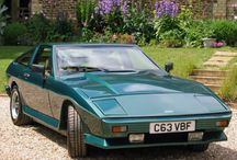 """TVR Tasmin / The TVR Tasmin or TVR 280i is a sports car designed and built by TVR from 1980 to 1988. It was the first of TVR's """"Wedge""""-series which formed the basis of nearly their entire 1980's lineup. It was available as a fixed head coupé, both as a 2-seater and as a 2+2, or as a 2-seater convertible."""