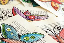 Painting butterflies on book pages,