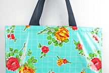 Laredo Collection Tote Bags, stylish bags that are practical and necessary! / We offer Laredo Collection in 4 sizes of Tote Bags... Beach Bag, Mini Carry On, Large Tote, Market Tote, All bags feature our Faux Leather Bottoms/Sides. The Mini Carry On has a zipper closure. Personalization can be a name or initial(s).