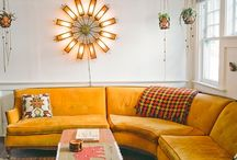 Warmth / Warmth created by natural woods, copper, heavy throws and dark back drops