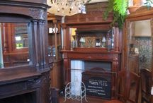 Architectural Salvage  Fireplace Mantels / Beautiful  mantels ....some are iron...most are wood either painted, refinished or in original stain finish.  We have half mantels and full mantels with mirrors.  Intricate gorgeous hand carving on many and/or with turned columns.  Quite a collection.