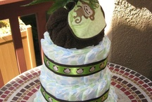 DIAPER CAKES by Heather / They make a wonderful gift or center piece at baby showers and/or infant birthday parties!  / by Heather Sorenson