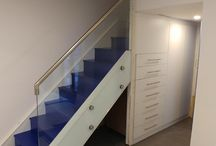 Glass & wooden staircase with vibrant blue stain