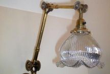 "Dugdill Patent / A  brass triple-adjustable wall light with stamped mark ""Dugdill Patent"" complemented with a holophane glass lampshade. England c1920-30"