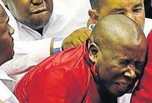 Malema lambasts white shirts for 'squeezing his balls'