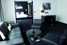 Rooms / Rooms of the Be Manos Hotel, going from standard room to suite. Decorated in a black & white design modern style