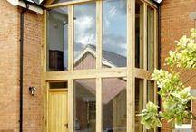 Venables Oak project: Craft Cottage / complete bespoke interior and exterior joinery including doors, garage, oak staircase, windows. Glazed oak atrium frame.