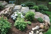 Landscaping slopes next to stairs