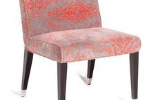 ORNAMENT / Eine gelungene und moderne Interpretation eines Polsterstuhls ist ORNAMENT von fleur ami: Er besticht durch ein Massivholzgestell, polierte Edelstahlfüße & graubeigen Samt mit Orange-farbenen Ornamenten. • ORNAMENT from fleur ami: a modern & lovely interpretation of an upholstered chair. Solid wood base, polished stainless steel feet & grey beige velvet with orange accents.