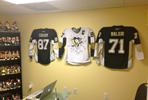 Pittsburgh Penguins / Pittsburgh Penguins jerseys displayed using the Ultra Mount jersey display hanger. A great affordable alternative to jersey frames.