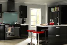 Black Gloss Kitchens / A selection of stunning contemporary kitchens with sleek, high gloss polished slab style doors.