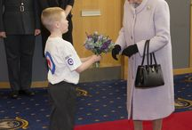 The Queen meets children from Airplay at RAF Lossiemouth / On 20 November Her Majesty The Queen and the Duke of Edinburgh met children from our Airplay programme during a visit to RAF Lossiemouth. Her Majesty was presented with a posy from eight-year-old Lennon Gallagher and was also shown photos that the children had taken in their photography activity club. Take a look at some photos of The Queen's visit.
