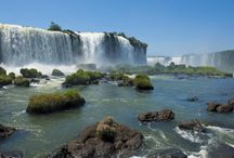 Iguazu Falls / Dwarfing Niagara, these roaring torrents of water are one of the planet's greatest natural sights. http://www.secretearth.com/attractions/1313-iguazu-falls