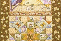 Pretty Panel Quilts / Display a favorite fabric panel in a quilt meant to show it off! See the latest fabric panels and get a FREE quilt pattern to highlight your favorites. / by American Patchwork & Quilting