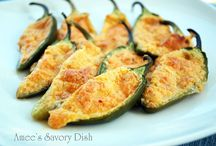 """Jalapeno & Pepper Cuisine / Stuffed jalapeños are hollowed out fresh jalapeños (served cooked or raw) that are stuffed, often with a mix containing seafood, meat, poultry, and/or cheese. Jalapeño poppers are an appetizer; jalapeños are stuffed with cheese, usually cheddar or cream cheese, breaded or wrapped in bacon, and cooked.Armadillo eggs are jalapeños or similar chilis stuffed with cheese, coated in seasoned sausage meat and wrapped in bacon. The """"eggs"""" are then grilled until the bacon starts to crisp. / by Brenda Law"""