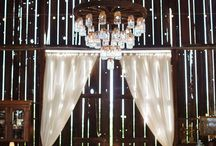 rustic arch curtain & chandelier