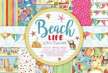Helz Cuppleditch - Beach Life / Capture the excitement of a summer's day at the seaside in your crafts with the Helz Cuppleditch Beach Life paper craft collection. Within the paper pack, find adorable illustrations which capture everything we love most about a day at the beach – from beach huts and deck chairs, to sandcastles and ice creams - along with a selection of cheerful patterns in an array of vibrant colours.