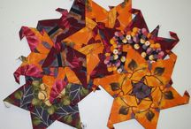 Hexagon/EPP Ideas & Fragments & Unfinished / EPP ideas for quilts and other items.  'Fragments' refers to pictures that are not obviously finished quilts or pictures of only part of a quilt (especially not showing the border) or pictures of bits and pieces of hexagon related 'stuff'. / by Nancy Atkinson
