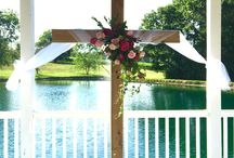 A Ceremony at the Gazebo / A Place in the Vineyard has a beautiful, classic white and hunter green gazebo overlooking a pond and fountain. This location is perfect for the classic or modern bride!